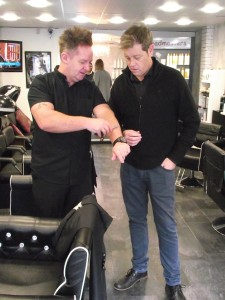 Simon Burgess (right) with Rob Grosvenor (Left) of Headmasters showing Simon Burgess how to hold the razor