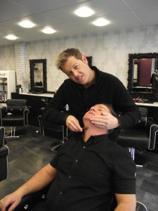 Simon Burgess (standing) demonstrating his new skills on Rob Grosvenor of Headmasters